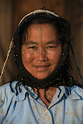 Apatani woman & facial tattoos<br /> Apatani Tribe<br /> Ziro Valley, Lower Subansiri District, Arunachal Pradesh<br /> North East India