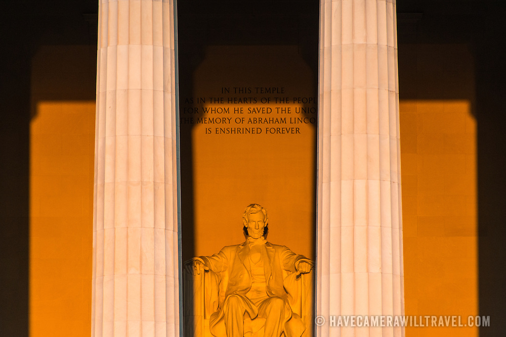 The statue of Abraham Lincoln in the Lincoln Memorial catches the very early morning sun during the equinox when the sun rises directly to the east.