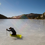 Extremely rare, warm weather in the Eastern Sierras has resulted in Tioga Pass (SR 120) remaining open into Yosemite National Park. It's been over 80 years since Tioga Pass was open this late into January. Locals and tourists alike enjoy frozen Tenaya Lake.
