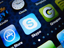 detail of iPhone 4G screen showing Skype internet phone app icon