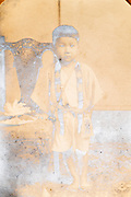 fading silverized image of young boy Japan ca 1950s