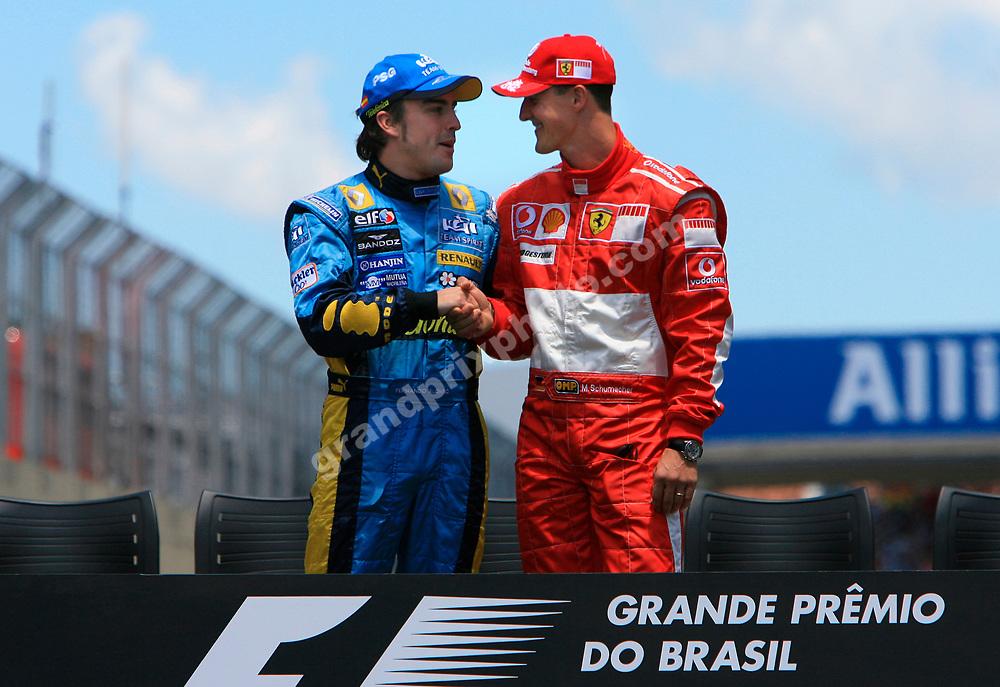 Fernando Alonso (Renault) and Michael Schumacher (Ferrari) shaking hands before the 2006 Brazilian Grand Prix at Interlagos. Photo: Grand Prix Photo