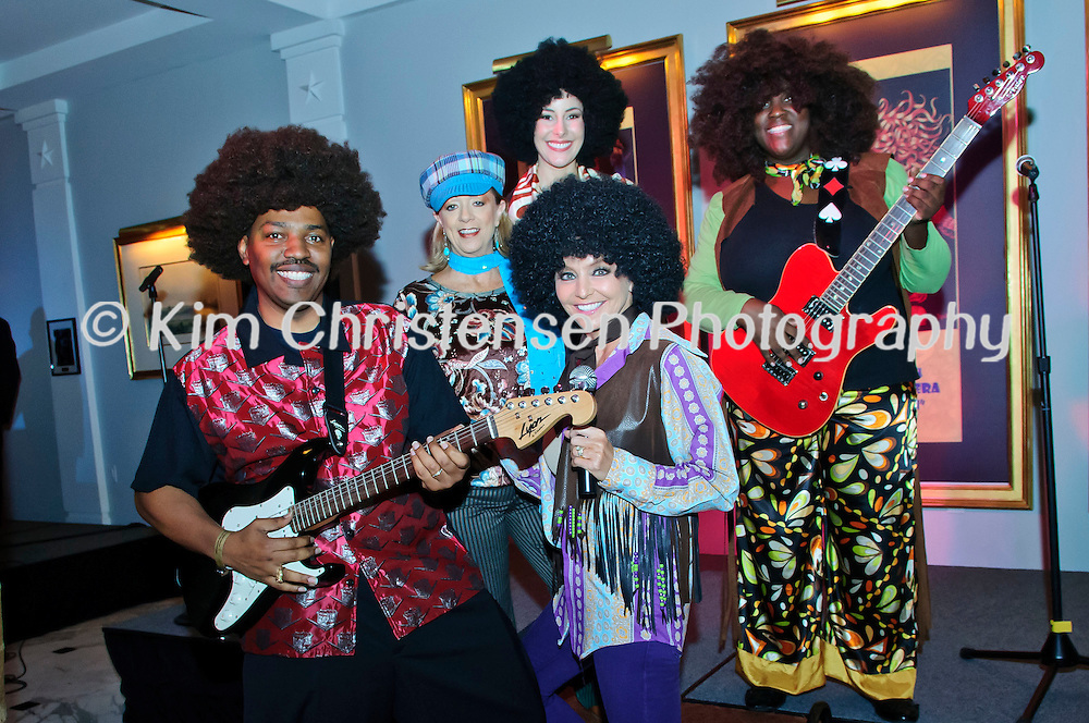 """Sam Collins, left front with Gina Spagnola, Teri Simpton back left Erin Kay center and Kelly-Ann Clarke dress up as the """"Jackson Five"""" at The Tremont House Mardi Gras celebrate """"The Golden Era of Motown"""" ball."""