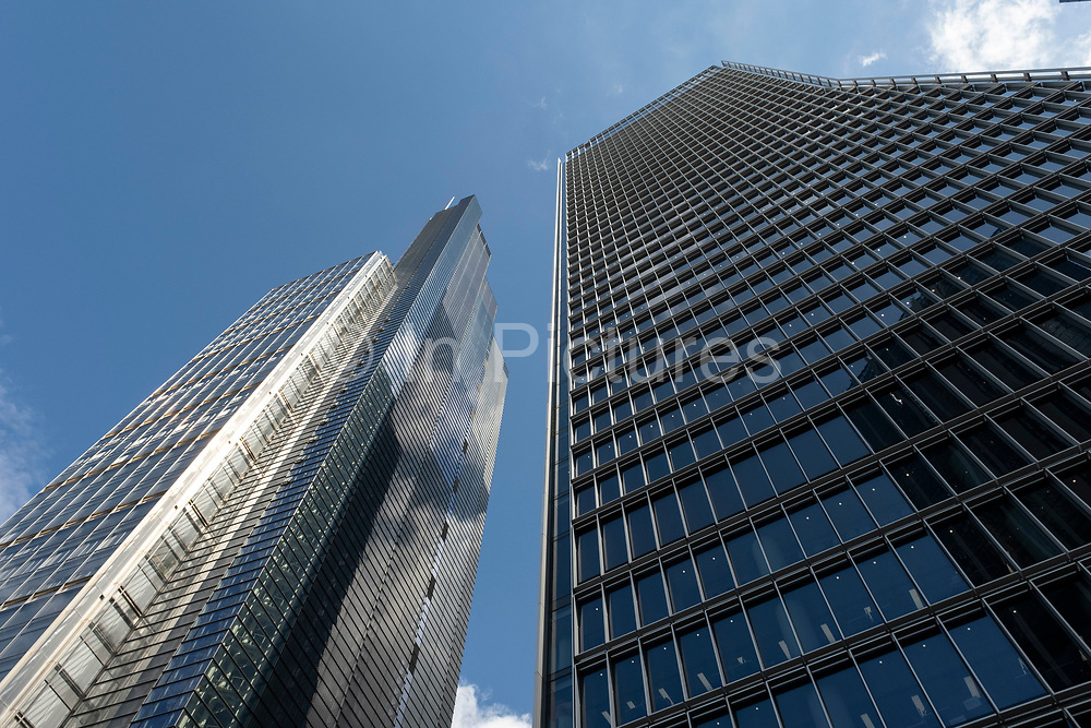 Old and new architecture in the City of London with older classical buildngs and the modernism of 100 Bishopsgate and Heron Tower on 26th May 2021 in London, United Kingdom. As the financial district grows in height, the architecture has changed the face of London with many different companies occupying the various floors and levels, some of which remain empty as overseas investments.
