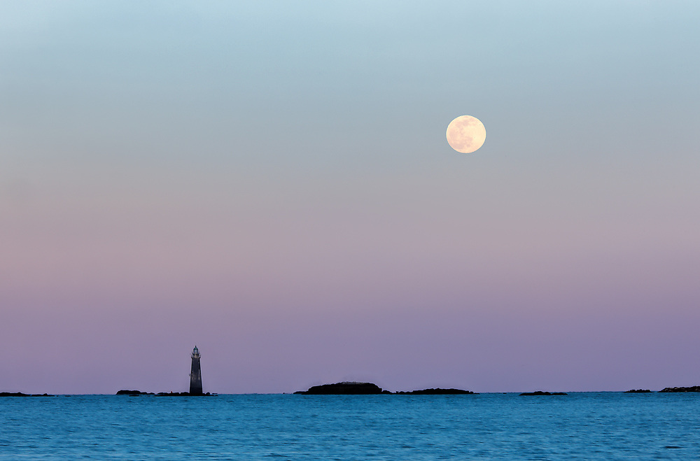 Snow full moon rising behind Minot's Ledge Light officially called Minots Ledge Lighthouse located offshore of Cohasset and Scituate, Massachusetts. Photo taking from Sandy Beach in the town of Cohasset.<br /> <br /> Massachusetts Minot's Ledge Lighthouse photography with the Snow Full Moon seascape photography photos are available as museum quality photo, canvas, acrylic, wood or metal prints. Wall art prints may be framed and matted to the individual liking and interior design decoration needs:<br /> <br /> https://juergen-roth.pixels.com/featured/minots-ledge-lighthouse-with-full-snow-moon-juergen-roth.html<br /> <br /> Good light and happy photo making!<br /> <br /> My best,<br /> <br /> Juergen