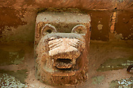 Norman Romanesque exterior corbel no 12 - sculpture of the head of an animal with a lions mane and big fanged teeth. The Norman Romanesque Church of St Mary and St David, Kilpeck Herefordshire, England. Built around 1140 .<br /> <br /> Visit our MEDIEVAL PHOTO COLLECTIONS for more   photos  to download or buy as prints https://funkystock.photoshelter.com/gallery-collection/Medieval-Middle-Ages-Historic-Places-Arcaeological-Sites-Pictures-Images-of/C0000B5ZA54_WD0s