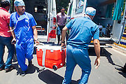 24 May 2016 , Mumabi airport - INDIA:]<br /> <br /> Doctors overcome heavy traffic & Transport Donor Heart Across cities in India for Heart Transplant in under 4 hours.<br /> <br /> As the Donor Heart arrives at Mumbai Airport from Surat the doctors transfer the deep frozen heart from the Airport ambulance to Fortis Ambulance Outside airport.<br /> Mumbai Police Officers form a 'green corridor' - a traffic management system for quick transport-  outside the Mumbai airport to enable the Doctors from Fortis Hospital to transport the Donor Heart which was arriving from Surat ( a town 300 kilometers away) by special flight for Heart Transplant Operation at Fortis Hospital in Mumbai.<br /> ©Exclusivepix Media