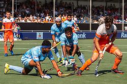 (L-R) Birenda Lakra of India, Sunil Sowmarpet Vitalacharya of India, Robbert Kemperman of The Netherlands during the Champions Trophy match between the Netherlands and India on the fields of BH&BC Breda on June 30, 2018 in Breda, the Netherlands