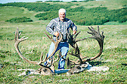 Caribou hunter with prize.