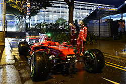 September 17, 2017 - Singapore - German driver SEBASTIAN VETTEL looks at his shattered Ferrari after crashing out at the beginning of the Formula One Grand Prix of Singapore. (Credit Image: © Hoch Zwei via ZUMA Wire)