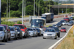 © Licensed to London News Pictures. 23/07/2016<br /> Traffic coming off M20 at Junction 11.<br /> Dover bound traffic and local traffic coming OFF the M20 at Junction 11 and heading towards Hythe to avoid the queueing traffic into Dover because of very long delays at French border contol. <br /> <br /> <br /> (Byline:Grant Falvey/LNP)
