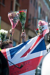 June News Shift- An EDL (English Defence League) organised event to lay flowers at Barkers Pool War Memorial Sheffield,  in memory of Drummer Lee Rigby, resulted in a two hour stand off when Sheffield Unite Against Fascism and One Sheffield Many Cultures supporters occupied Barkers Pool and surrounded the War Memorial leaving police to keep the opposing factions apart. <br /> EDL supporters hold flowers up Bunches of flowers they are wanting to lay at the War Memorial<br /> <br /> 1 June 2013