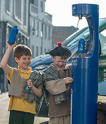 Youngsters paid tribute to one of Dumfries' most celebrated former residents when they unveiled a new water refill tap in the town.<br /> <br /> The high tech Top Up Tap has been installed by Scottish Water as part of its national initiative to encourage people to carry a reusable bottle and stay hydrated on the go. <br /> <br /> Pictured: Primary 2 pupils from Noblehill Primary School who donned 18th century outfits and recited some poems by Robert Burns.