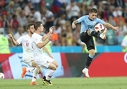 SOCHI, June 30, 2018  Lucas Torreira (R) of Uruguay controls the ball during the 2018 FIFA World Cup round of 16 match between Uruguay and Portugal in Sochi, Russia, June 30, 2018. (Credit Image: © Fei Maohua/Xinhua via ZUMA Wire)