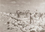 A group of Jewish Pioneers (Chalutzim) Road building in the Negev Desert. Photographed in Palestine / Israel circa 1940