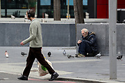 """A homeless person with mental concerns is seen stranded nearby London Bridge station on Wednesday, April 8, 2020. The barometer of the success of any nation is the health and wellbeing of its people. Mental health services are free on the NHS. Approximately 1 in 4 people in the UK will experience a mental health problem each year. In England, 1 in 6 people report experiencing a common mental health problem (such as anxiety and depression) in any given week says the NHS Information Centre for health and social care. With the UK Conservative government consistently defunding public health institutions a damning report found 'serious failings' in NHS mental health services. Vulnerable mental health patients are suffering serious harm, and in some cases dying, because of """"serious failings"""" in their treatment, the NHS ombudsman has warned. (Photo/Vudi Xhymshiti)"""