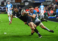 Ospreys' Dan Evans is tackled by Leinster's Jack Conan<br /> <br /> Photographer Craig Thomas/Replay Images<br /> <br /> Guinness PRO14 Round 18 - Ospreys v Leinster - Saturday 24th March 2018 - Liberty Stadium - Swansea<br /> <br /> World Copyright © Replay Images . All rights reserved. info@replayimages.co.uk - http://replayimages.co.uk