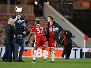 Patrick Bamford of Middlesbrough with the match ball and Adama Traoré of Middlesbrough being interviewed for SKY TV at full time  during the EFL Sky Bet Championship match between Middlesbrough and Leeds United at the Riverside Stadium, Middlesbrough, England on 2 March 2018. Picture by Paul Thompson.