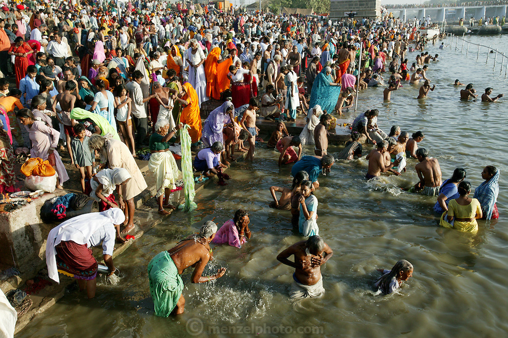 Pilgrims take their turn to bath in the Shipra River during the Kumbh Mela festival, Ujjain, Madhya Pradesh, India. (From the book What I Eat: Around the World in 80 Diets.)