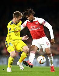 BATE Borisov's Maksim Skavysh (left) and Arsenal's Alex Iwobi battle for the ball