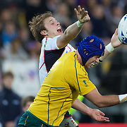 Colin Hawley, USA, challenges Nathan Sharpe, Australia, for the ball  during the Australia V USA, Pool C match during the IRB Rugby World Cup tournament. Wellington Stadium, Wellington, New Zealand, 23rd September 2011. Photo Tim Clayton...