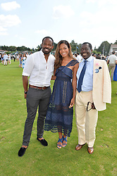 Left to right, CHIKÉ OKONKWO, NAOMIE HARRIS and PRINCE ALBERT ESIRI of Nigeria at The Royal Salute Coronation Cup Polo held at Guards Polo Club,  Smiths Lawn, Windsor Great Park, Egham on 23rd July 2016.