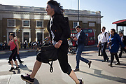 Commuters and other pedestrians walk over London Bridge, the oldest of the capital's crossing over the river Thames between the capital's financial district, the City of London, and Southwark on the south bank, on 15th May 2018, in London, UK.