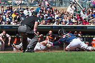 Chris Snyder #48 of the Baltimore Orioles is tagged out at home plate by Ryan Doumit #9 of the Minnesota Twins on May 12, 2013 at Target Field in Minneapolis, Minnesota.  The Orioles defeated the Twins 6 to 0.  Photo: Ben Krause