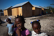Children play outside of their temporary homes at an American Red Cross project site in Port-au-Prince, Haiti.