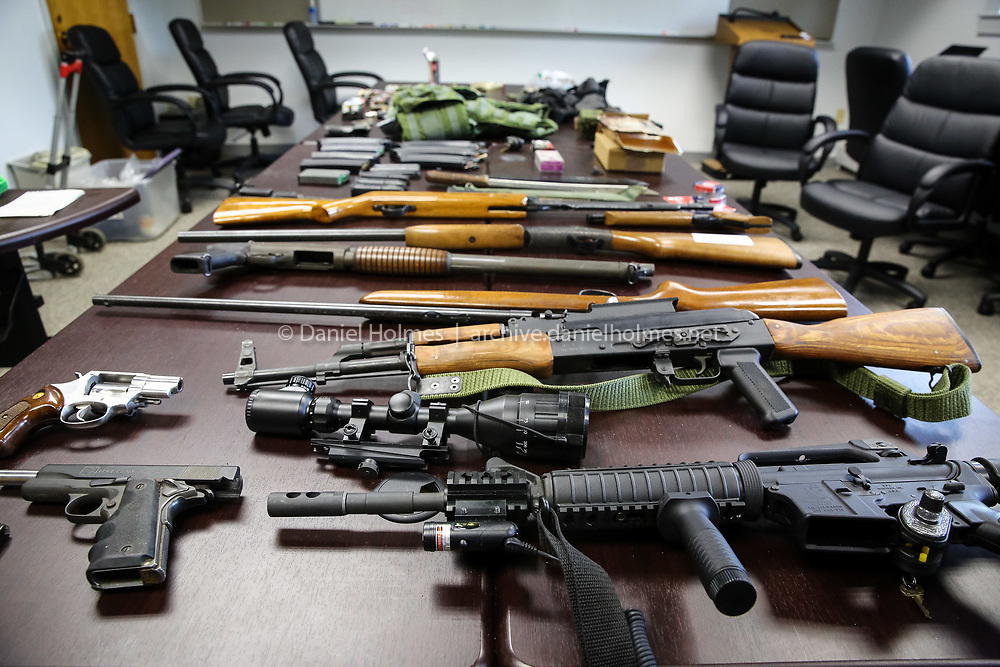 (9/22/15, MEDWAY, MA) Guns and ammunition that were seized by the Medway Police Department on Monday during an ongoing investigation displayed at Medway Police Department on Tuesday. Daily News and Wicked Local Photo/Dan Holmes