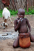 A Himba boy finishes cornmeal porridge in Okapembambu village, northwestern Namibia. (From the book What I Eat: Around the World in 80 Diets.) The Himba diet consists of corn meal porridge and sour cow's milk.