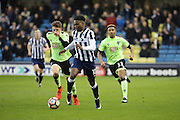 Millwall midfielder Fred Onyedinma (10) dribbling away from Bournemouth players during the The FA Cup 3rd round match between Millwall and Bournemouth at The Den, London, England on 7 January 2017. Photo by Matthew Redman.