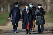 People some of them wearing face surgical protective mask walk throughout Hyde Park nearby Knights Bridge station in central London on Sunday, Mar 14, 2021. Coronavirus has hit the UK hard, with the country recording more than 3m cases and 125,000 deaths linked to the disease. (VXP Photo/ Vudi Xhymshiti)