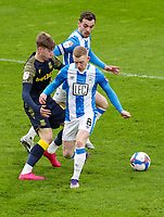 Stoke City's Jack Clarke battles with Huddersfield Town's Lewis O'Brien and Harry Toffolo<br /> <br /> Photographer Alex Dodd/CameraSport<br /> <br /> The EFL Sky Bet Championship - Huddersfield Town v Stoke City - Saturday 30th January 2021 - The John Smith's Stadium - Huddersfield<br /> <br /> World Copyright © 2021 CameraSport. All rights reserved. 43 Linden Ave. Countesthorpe. Leicester. England. LE8 5PG - Tel: +44 (0) 116 277 4147 - admin@camerasport.com - www.camerasport.com