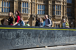 London, UK. 20 September, 2019. A message for politicians left on a security barrier outside the Houses of Parliament by students taking part in the second Global Climate Strike in protest against a lack of urgent action by the UK Government to combat the global climate crisis. The Global Climate Strike grew out of the Fridays for Future movement and is organised in the UK by the UK Student Climate Network.