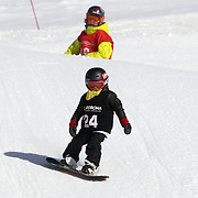 Campbell Melville-Ives, 5, from Wanaka, competing in the Snowboard Slopestyle Grommets event  during the Snow Sports NZ Junior Freeski and Snowboard Nationals at Cardrona Alpine Resort, Wanaka,  New Zealand, 27th September 2011. Photo Tim Clayton...