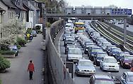 DEU, Germany, North Rhine-Westphalia, Ruhr area, Essen, the Autobahn A 40 in Essen-Frillendorf and houses at the Hombrucherstreet close to the Autobahn A 40, one of the most polluted areas in North Rhine-Westphalia and Germany, high concentration of cancer-causing fine particles caused by diesel engines.....DEU, Deutschland, Nordrhein-Westfalen, Ruhrgebiet, Essen, die Autobahn A 40 und Haeuser an der parallel verlaufenden Hombrucherstrasse in Essen-Frillendorf, hier werden die hoechsten Werte an Luftverschmutzung, Feinstaub in NRW und Deutschland gemessen.....[For each usage of my images the General Terms and Conditions are mandatory.]