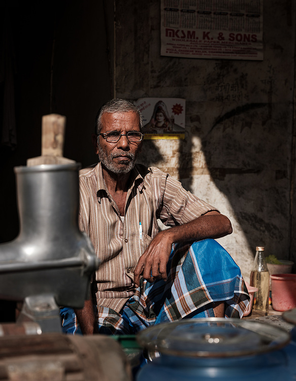 NEW DELHI, INDIA - CIRCA NOVEMBER 2018: Seller in the strees of Chandni Chowk area in Old Delhi.