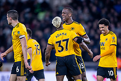 February 11, 2019 - Wolverhampton, England, United Kingdom - Willy Boly of Wolverhampton Wanderers celebrates with Adama Traore of Wolverhampton Wanderers after scoring the equalizer during the Premier League match between Wolverhampton Wanderers and Newcastle United at Molineux, Wolverhampton on Monday 11th February 2019. (Credit Image: © Mi News/NurPhoto via ZUMA Press)