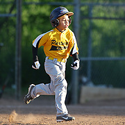 A runner heads for second base during the Norwalk Little League baseball competition at Broad River Fields, Norwalk, Connecticut. USA. Photo Tim Clayton
