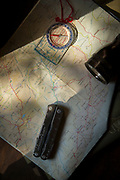 Flashlight and compass on map of South Luangwa National Park in Zambia