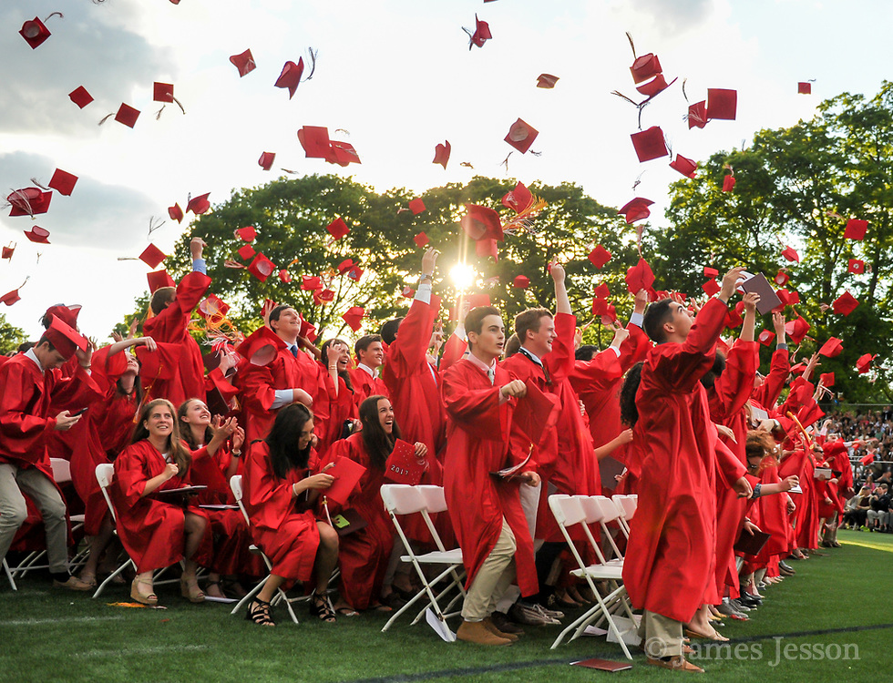 Graduates from the Class of 2017 throw their mortarboards during the 148th Graduation exercises at Wellesley High School on June, 2, 2017.   [Wicked Local Photo/James Jesson]