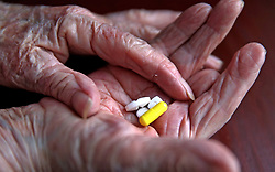 Embargoed to 0005 Tuesday August 1 File photo dated 03/09/15 of a pensioner with her daily prescription drugs. Almost all men over 60 and women over 75 are eligible for statins, according to a new analysis.