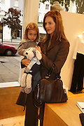 Trinny Woodall and her daughter Lyla, Comptoir des Cotonniers shop opening. Westbourne Grove. London. 25 October 2006. -DO NOT ARCHIVE-© Copyright Photograph by Dafydd Jones 66 Stockwell Park Rd. London SW9 0DA Tel 020 7733 0108 www.dafjones.com