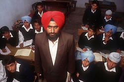 Male teacher with class of school boys in senior secondary modern school; Punjabi University; Patiala; Punjab; India,