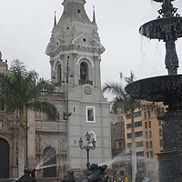 The Cathedral Church and a fountain in the main plaza of Lima, Peru.