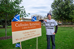 Protestors have set up camp outside the Scottish Parliament on the same land occupied by the Indy Camp group.<br /> <br /> They are protesting about the development of land on the area where it is believed the battle of Culloden took place in 1746. They protestors have stated that they will remain on the Parliament grounds until the bulldozers have been removed from the Culloden site.<br /> <br /> Pictured: Dean Halliday at the Parliament camp