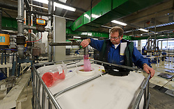 An AkzoNobel employee works in the paint production facility in Sassenheim, the Netherlands, Wednesday, Dec. 22, 2010. Akzo Nobel NV, the world's biggest paint maker, reported a 21 percent increase in third quarter net income to 238 million euros. (Photo © Jock Fistick)