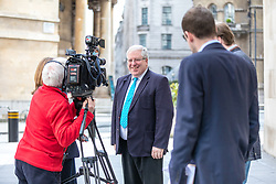 © Licensed to London News Pictures. 23/04/2017. London, UK. Chairman of the Conservative Party Patrick McLoughlin (centre) speaks to the media outside Broadcasting House before appearing on Sunday Politics. McLoughlin is reported to have said that Jeremy Corbyn, Leader of the Labour Party, 'is not suitable to become prime minister of this country' in the upcoming 8 June General Election. Photo credit: Rob Pinney/LNP