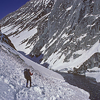 A ski mountaineer traverses avalanche debris beside a fork of the Warwan River in India's Great Himalaya Range.  This team of three skiers, who completed the first-ever ski traverse across the Himalaya from Ladakh to Kashmir, was later caught in an avalanche themselves.  The photographer suffered two crushed vertebrae by managed to ski the rest of the way back to civilization.